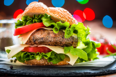 closeup of hamburger with fresh vegetables