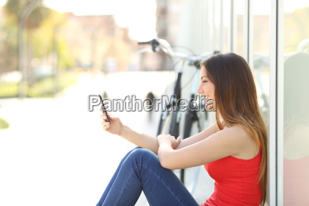 girl sitting using a mobile phone