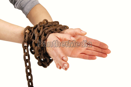 hands tied with chain isolated on