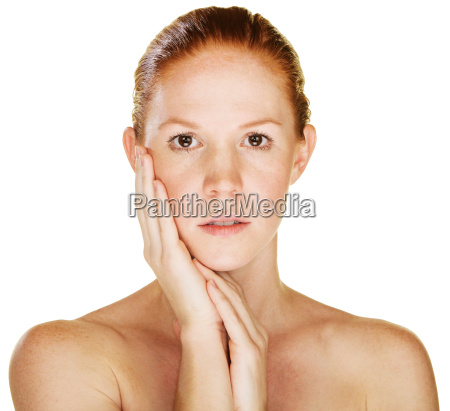 woman with palm on cheek