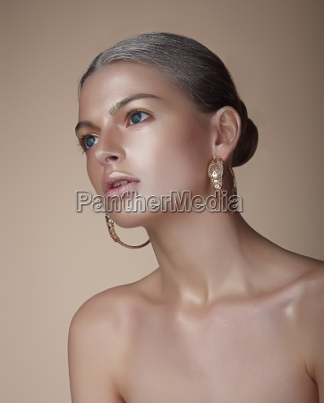 portrait of gorgeous woman with earrings