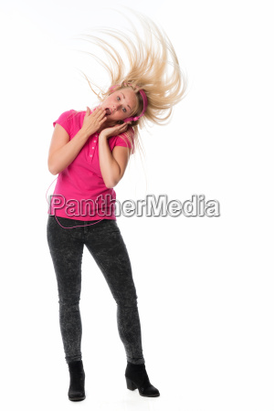 young woman with headphones listens to