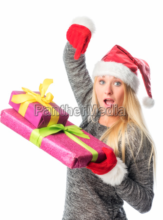 christmas woman pointing at gifts