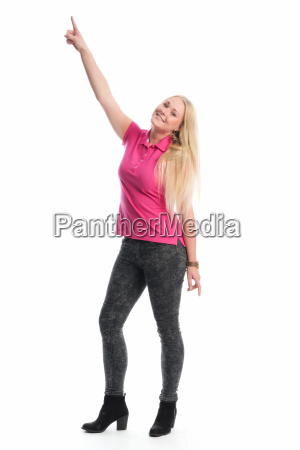 young blond woman points finger up