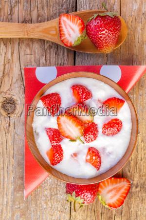 fresh organic greek yogurt with strawberries