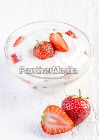 fresh organic yogurt with strawberries on