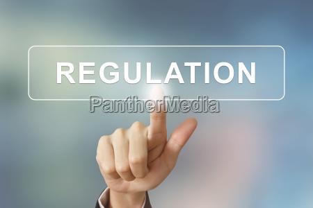 business hand clicking regulation button on