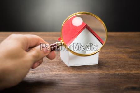 person hand with magnifying glass and