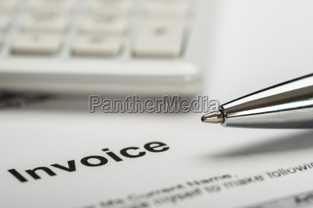 pen with calculator and invoice