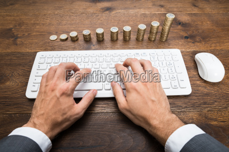 businessman using keyboard in front of