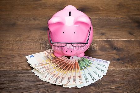 piggybank with euro notes