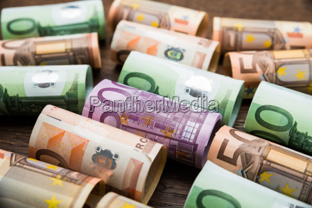 rolled euro banknotes