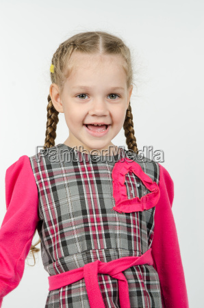 portrait of cheerful four year girl