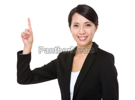 geschaeftsfrau mit fingerspitzengefuehl nach oben