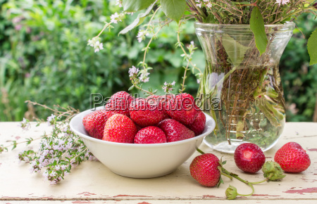 a white bowl with fresh strawberries