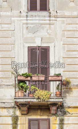 balcony with flowers in romes city