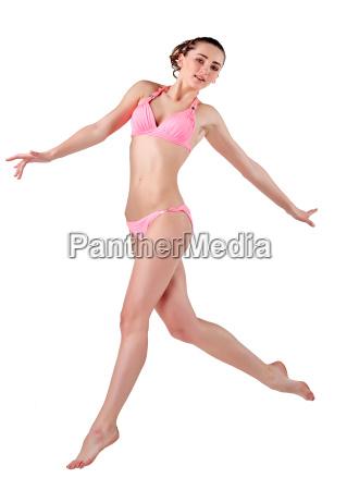 beautiful young woman in pink swimwear
