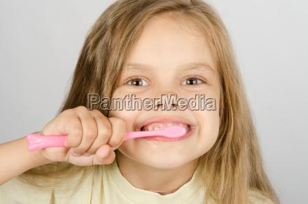 six year old girl brushing her