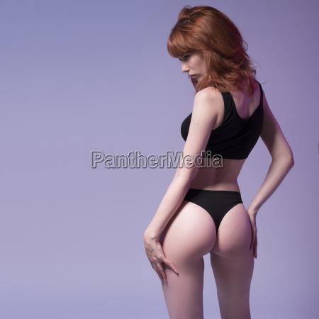 sexy redhead woman in fitness wear