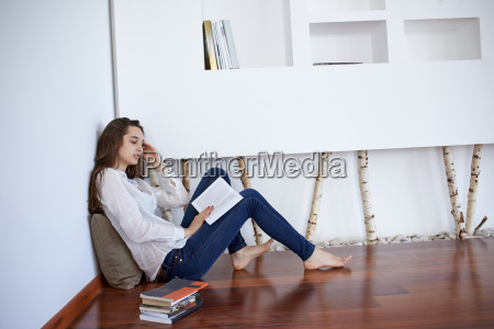relaxed young woman at home working