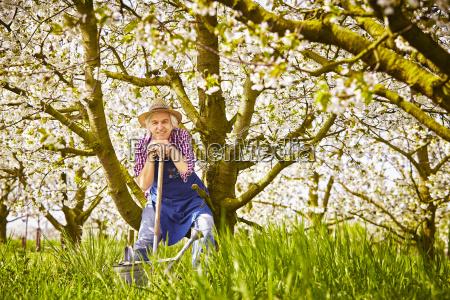 gardeners spade watering can trees