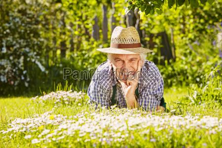man flower meadow horizontal format