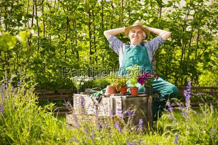 gardening straw hat laughing