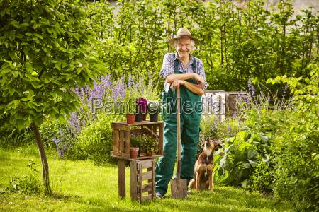 garden gardener straw hat spade standing