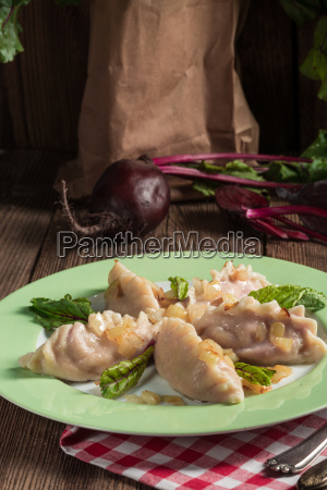 piquant pierogi with beetroot and cheese