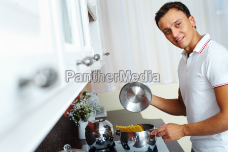 man cooking spaghetti