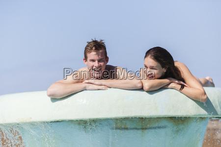 teenagers boy girl pool