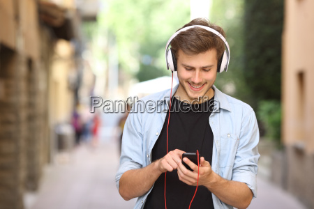 guy walking and using a smart