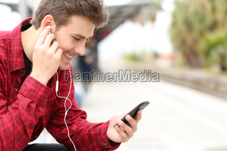 man listening to the music waiting