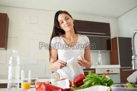 young woman cooking in the kitchen