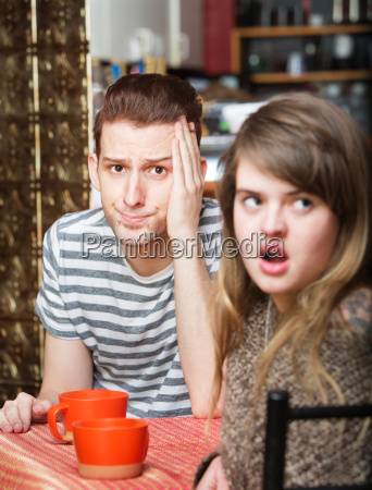 irritated woman with man