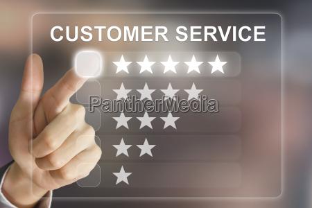 business hand pushing customer service on