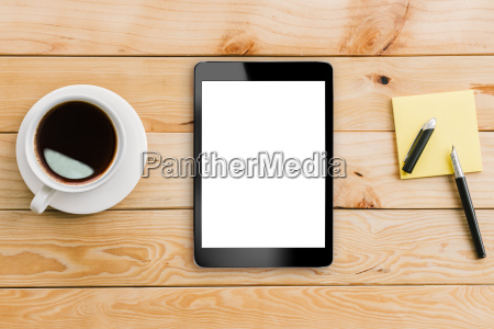 tablet weiss display und kaffee auf