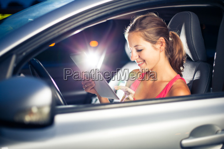 pretty female driver using her tablet