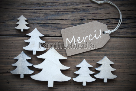 label and christmas trees merci means