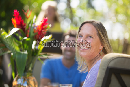 smiling woman at table on vacation