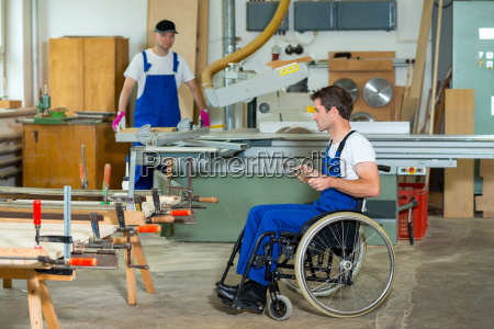 worker in wheelchair in a carpenters