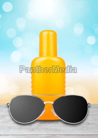 sun lotion with sunglasses and a