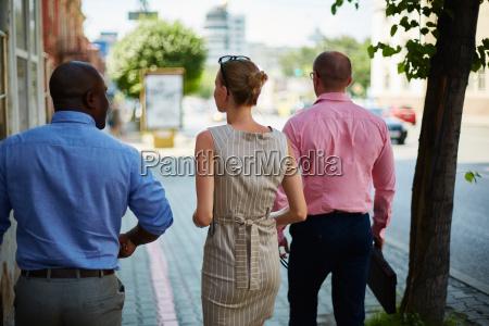 business people walking outside