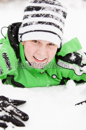 friendly young boy playing in winter