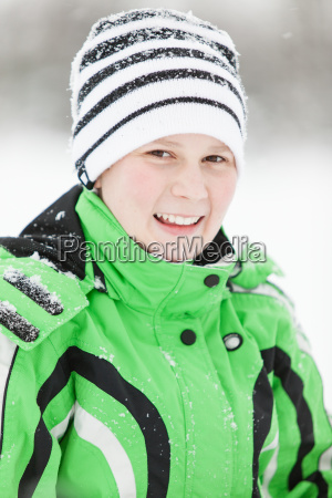 cold smiling young boy in winter