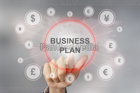 business hand pushing business plan button