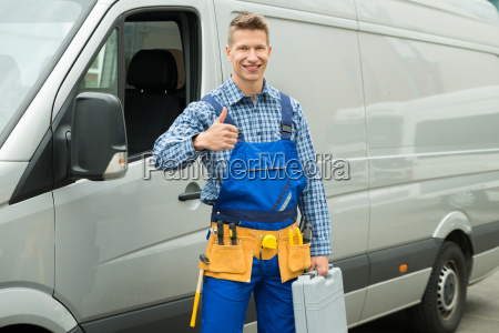 repairman with tools and toolbox showing