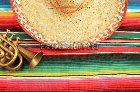 poncho sombrero mexico background with copy