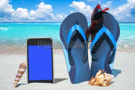 smartphone flip flops and sunglasses on