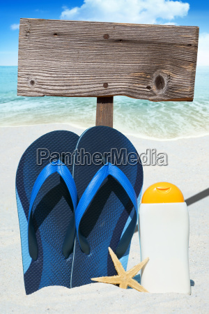 flip flops sunmilk and empty wooden